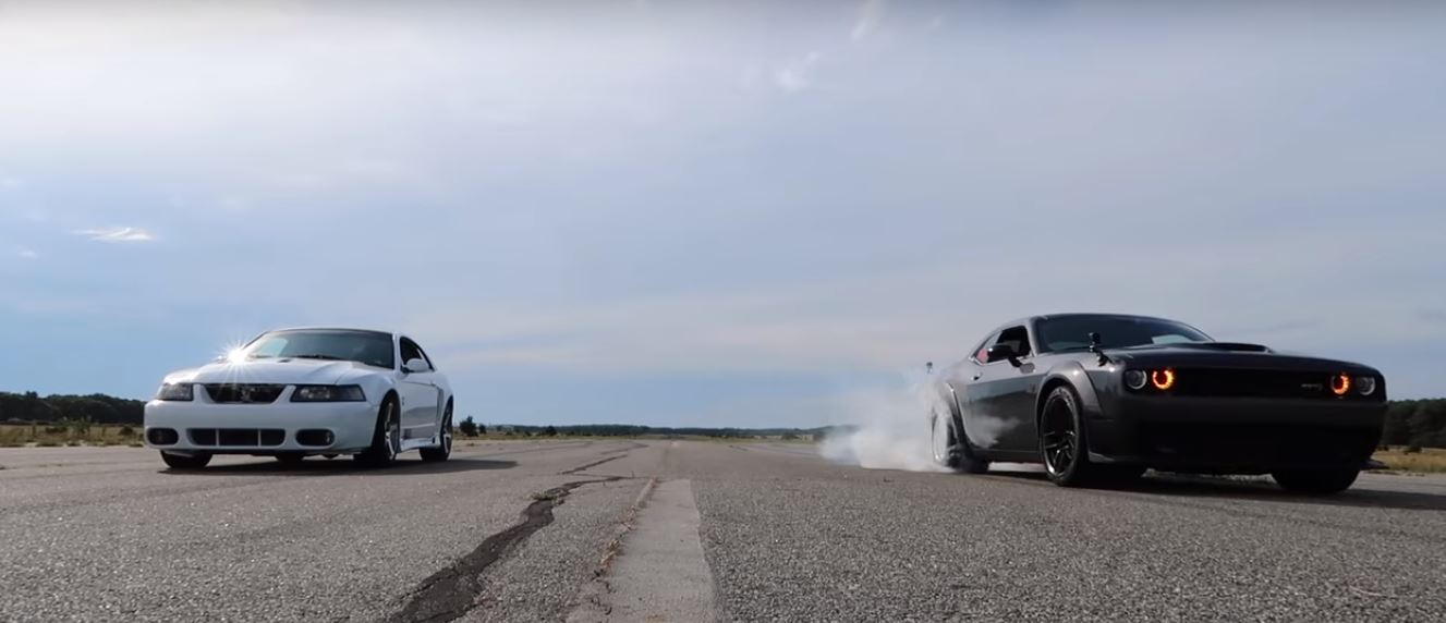 Ford Mustang SVT Cobra vs. Dodge Challenger Hellcat dragrace Video: Ford Mustang SVT Cobra vs. Dodge Challenger Hellcat