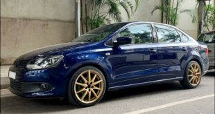 VW Vento TSI with golden alloy wheels in WRX STI style.